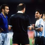 1990 World Cup Semi Final. Naples, Italy. 3rd July, 1990. Italy 1 v Argentina 1 (Argentina win 3-2 on penalties). Italian captain Giuseppe Bergomi and Argentine captain Diego Maradona are spoken to by the referee during the game.