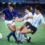 1990 World Cup Semi Final. Naples, Italy. 3rd July, 1990. Italy 1 v Argentina 1 (Argentina win 3-2 on penalties). Argentina's Jose Basualdo and Juan Simon challenge Italy's Roberto Donadoni for the ball.