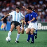1990 World Cup Semi Final. Naples, Italy. 3rd July, 1990. Italy 1 v Argentina 1 (Argentina win 3-2 on penalties). Argentina's Jorge Burruchaga is challenged for the ball by Italy's Salvatore Schillaci.