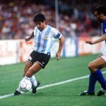 1990 World Cup Semi Final. Naples, Italy. 3rd July, 1990. Italy 1 v Argentina 1 (Argentina win 3-2 on penalties). Argentina's Diego Maradona shields the ball from Italy's Giuseppe Bergomi.