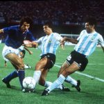 1990 World Cup Semi Final. Naples, Italy. 3rd July, 1990. Argentina 1 v Italy 1 (Argentina win 3-2 on penalties). Italy's Roberto Donadoni is challenged for the ball by Argentina's Juan Ernesto Simon and Jose Basualdo.