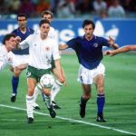 1990 World Cup Quarter Final. Rome, Italy. 30th June, 1990. Italy 1 v Republic Of Ireland 0. Italy's Luigi De Agostini battles for the ball with Republic of Ireland's Ray Houghton (left) and John Aldridge.