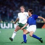 1990 World Cup Quarter Final. Rome, Italy. 30th June, 1990. Italy 1 v Republic Of Ireland 0. Italy's Carlo Ancelotti plays the ball past Republic of Ireland's Mick McCarthy.