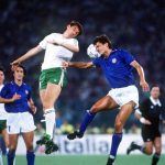 1990 World Cup Quarter Final. Rome, Italy. 30th June, 1990. Italy 1 v Republic Of Ireland 0. Republic of Ireland's Tony Cascarino battles for the ball in the air with Italy's Paolo Maldini.