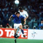 1990 World Cup Quarter Final. Rome, Italy. 30th June, 1990. Italy 1 v Republic Of Ireland 0.Italy's Roberto Baggio is beaten to the ball in the air by Republic Of Ireland's Kevin Moran.