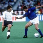 1990 World Cup Third Place Play Off. Bari, Italy. 7th July, 1990. Italy 2 v England 1. Italy's Carlo Ancelotti is challenged for the ball by England's Peter Beardsley.
