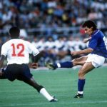 1990 World Cup Third Place Play Off. Bari, Italy. 7th July, 1990. Italy 2 v England 1. Italy's Roberto Baggio shoots past England defender Paul Parker.