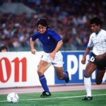 1990 World Cup Finals. Second Phase. Rome, Italy. 25th June, 1990. Italy 2 v Uruguay 0. Italy's Fernando De Napoli is chased for the ball by Uruguay's Jose Pintos.