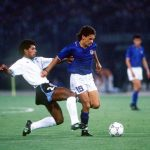 1990 World Cup Finals. Second Phase. Rome, Italy. 25th June, 1990. Italy 2 v Uruguay 0. Italy's Roberto Baggio is challenged for the ball by Uruguay's Ruben Pereira.