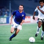 1990 World Cup Finals. Second Phase. Rome, Italy. 25th June, 1990. Italy 2 v Uruguay 0. Italy's Salvatore Schillaci chases after the ball with Uruguay's Ruben Pereira.