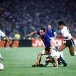 1990 World Cup Finals. Second Phase. rome, Italy. 25th June, 1990. Italy 2 v Uruguay 0. Italy's Salvatore Schillaci chases after the ball past Uruguay's fallen Dominguez.
