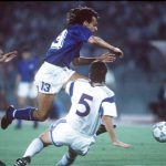 1990 World Cup Finals, Rome, Italy, 14th June, 1990, Italy 1 v USA 0, Italy's Giuseppe Giannini leaps over the challenge of USA's Mike Windischmann on his way to scoring the only goal of the game