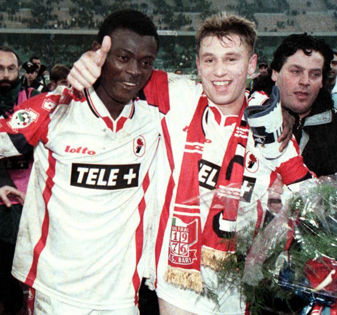 Bari's Ennynaya and Cassano celebrate at the end of Bari vs Inter Italian first division soccer match in Bari, Italy, Saturday, December 18, 1999. Bari won 2-1. (AP Photo/Vittorio Arcieri)