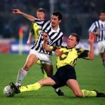 Football. UEFA Cup Final, Second Leg. Turin, Italy. 19th May 1993. Juventus 3 v Borussia Dortmund 0 (Juventus win 6-1 on aggregate). Gianluca Vialli of Juventus is tackled by Borussia Dortmund's Schmidt.