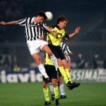 Football. UEFA Cup Final, Second Leg. Turin, Italy. 19th May 1993. Juventus 3 v Borussia Dortmund 0 (Juventus win 6-1 on aggregate). Dino Baggio of Juventus, who scored two goals on the game, wins a header despite a challenge from Borussia Dortmund's Schm