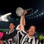 Football. UEFA Cup Final, Second Leg. Turin, Italy. 19th May 1993. Juventus 3 v Borussia Dortmund 0 (Juventus win 6-1 on aggregate). Gianluca Vialli (right) holds the trophy aloft as he celebrates with his team-mates.